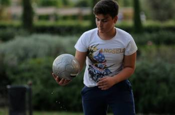 Italian boy plays soccer in Italy