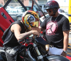 The brother of singer Jadiel consoles crying biker during memorial