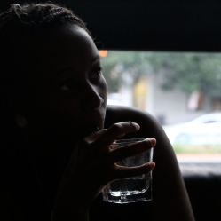 Woman enjoys beverage in lounge
