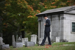 Man walks through cemetery in Rochester, NY