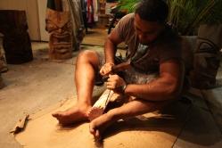 Hawaiian man carves wood