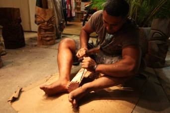 Hawaiian man carves wood