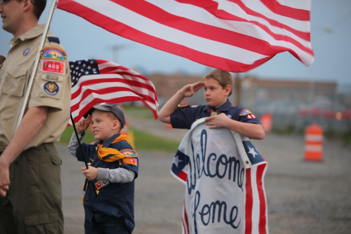 Boy scouts salute during memorial inRochester, NY