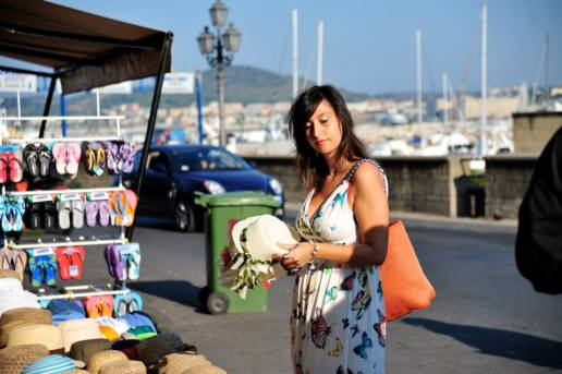 Italian woman shops near the bay in Naples