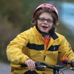 Young boy rides in park in Rochester