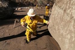 Dennis Staley studies landslide aftermath