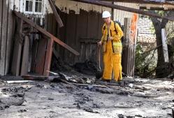 Scientist studies debris flow aftermath